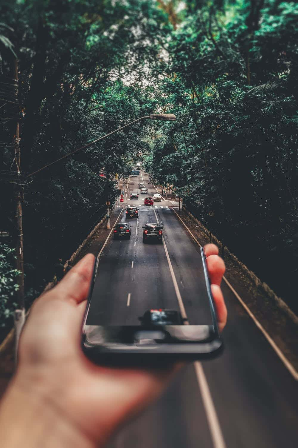 a 3dd creative photo of cars and a phone