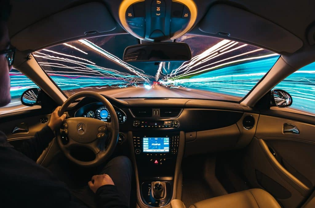 futuristic photo of a man drivig a car